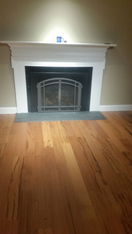 Brazilian Koa Floor & Soapstone Hearth